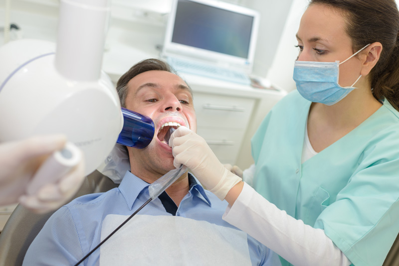 dentist-doing-digital-xray-in-dentist-office